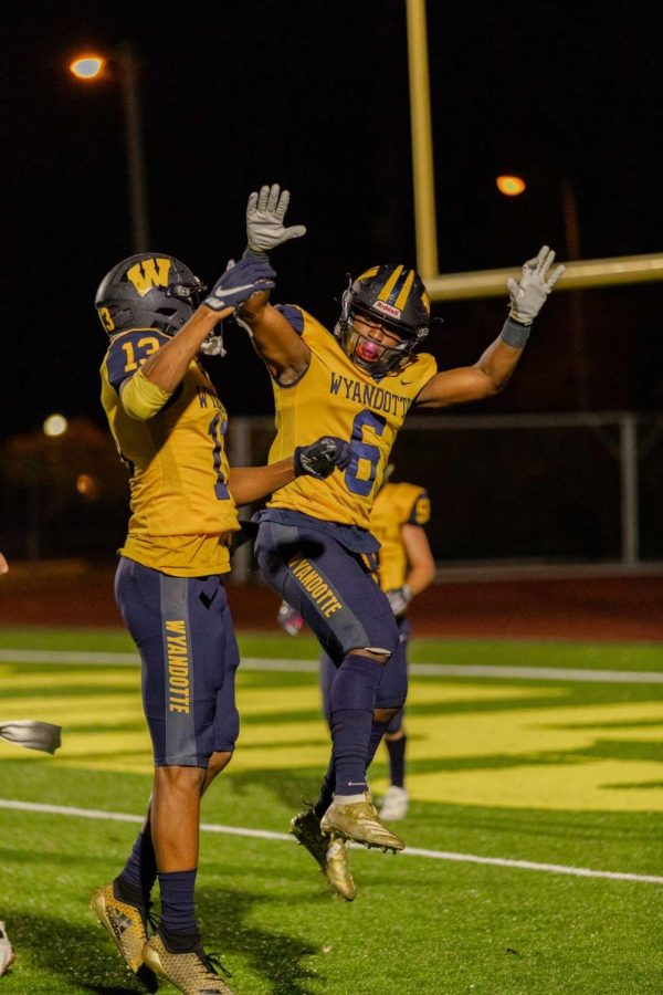 Number+six%2C+Jalin+Pitchford%2C+and+number+13%2C+Richard+Clark%2C+celebrating+a+touchdown+during+their+2020+senior+season.