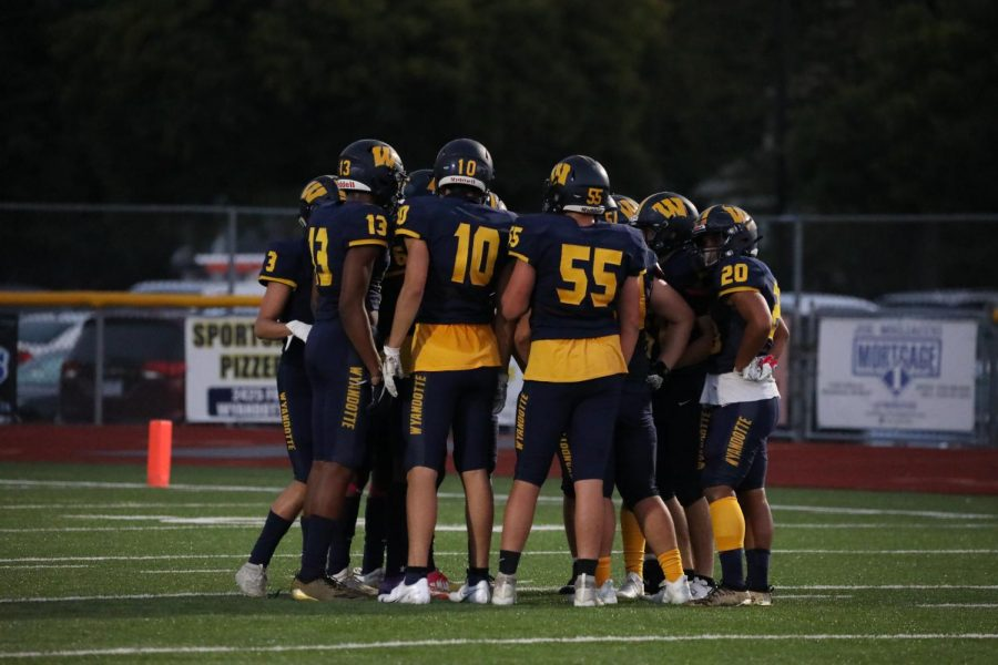 The Bears huddle and prepare for another play.