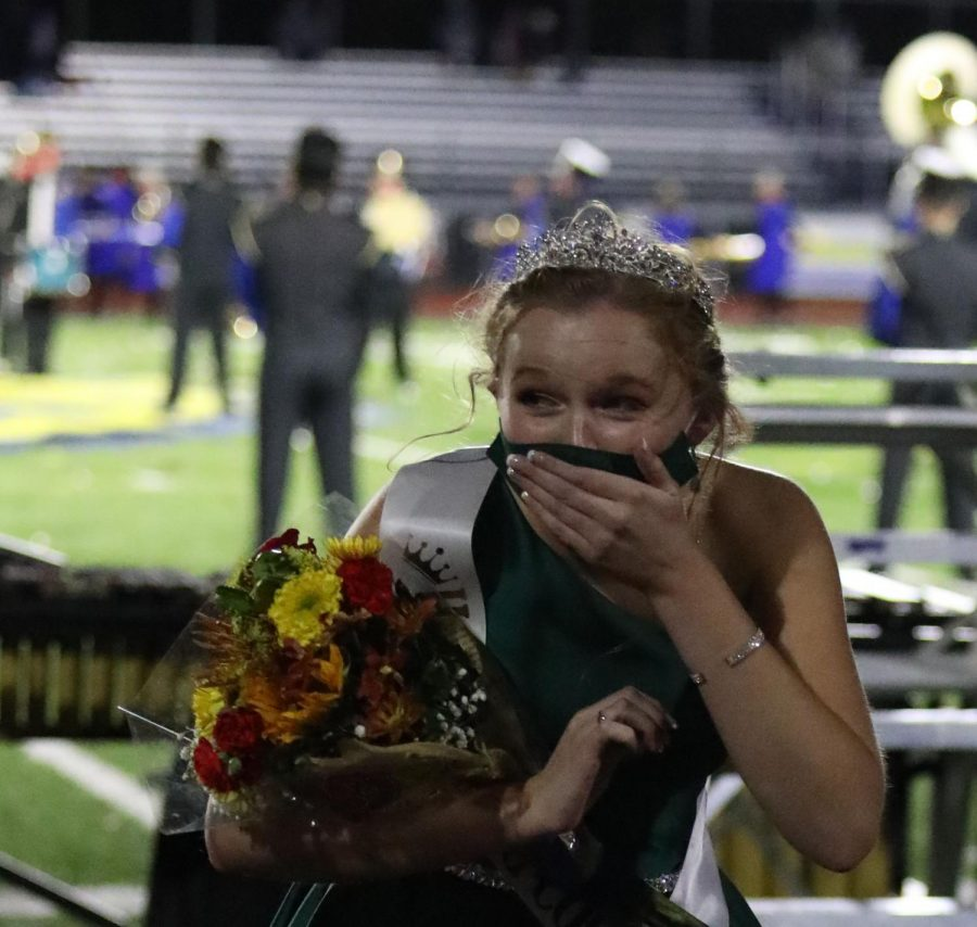 Senior Cordelia Krajewski covers her mouth in disbelief as she is announced Homecoming Queen.