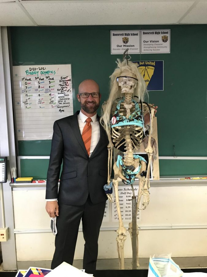 David Blake posing with his biology partner, Edna. It is a tradition for Blake and his students to dress Edna up for holidays. Edna is still in her summer attire shown here.