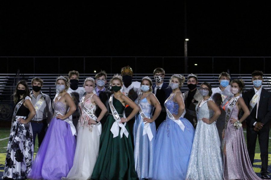 The+2020+Homecoming+court+met+after+the+game+to+get+photos+since+there+is+no+dance+this+year+to+take+pictures+during.+Homecoming+Queen+Cordelia+Krajewski+and+King+Jalin+Pitchford+are+in+the+center+of+the+group.
