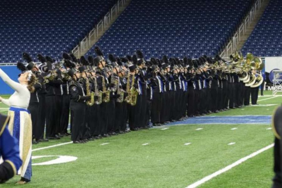 Cordelia Krajewski performs with the Wyandotte Marching Chiefs at Ford Field prior to Covid.
