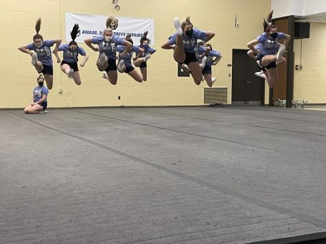The cheer team practices their jump sequence the day before their first competition.