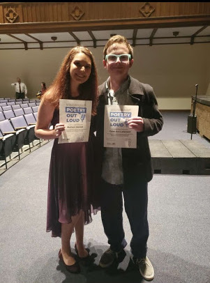 Seniors Madison Ganzak and Caleb Ave-Lallemant pose for a picture after last years Poetry Out Loud performance.