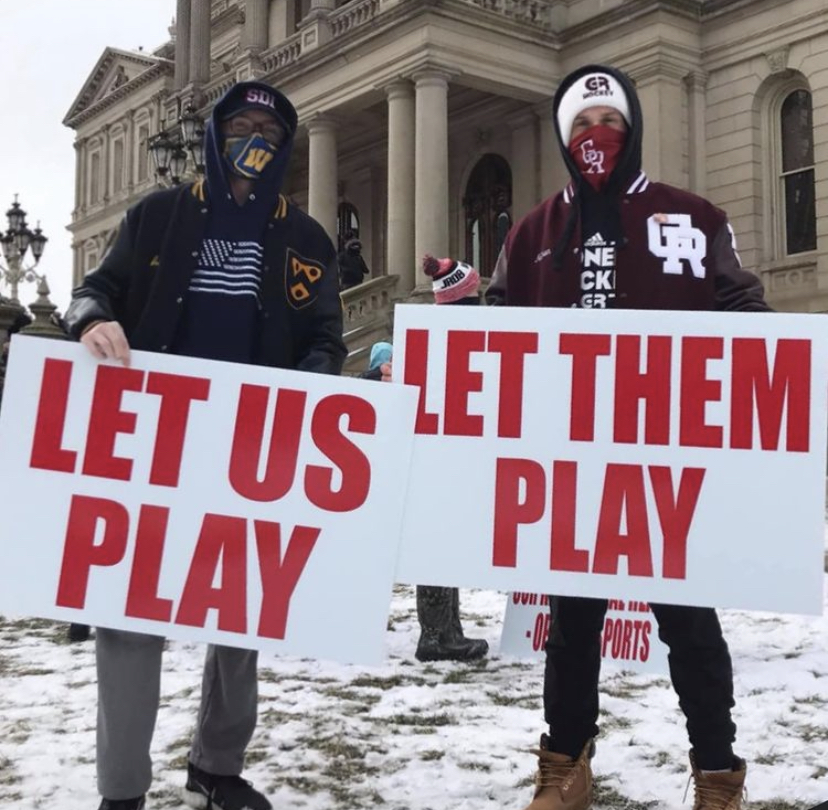 Aden Jordan and former RHS student Nathan Schwein protesting at the capitol building in Lansing for the Let Them Play movement.