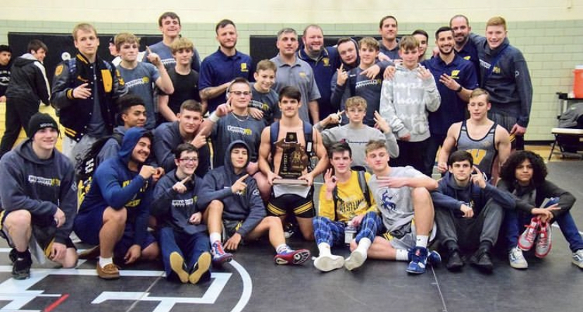 The 2019-20 wrestling team poses in a pre-pandemic environment