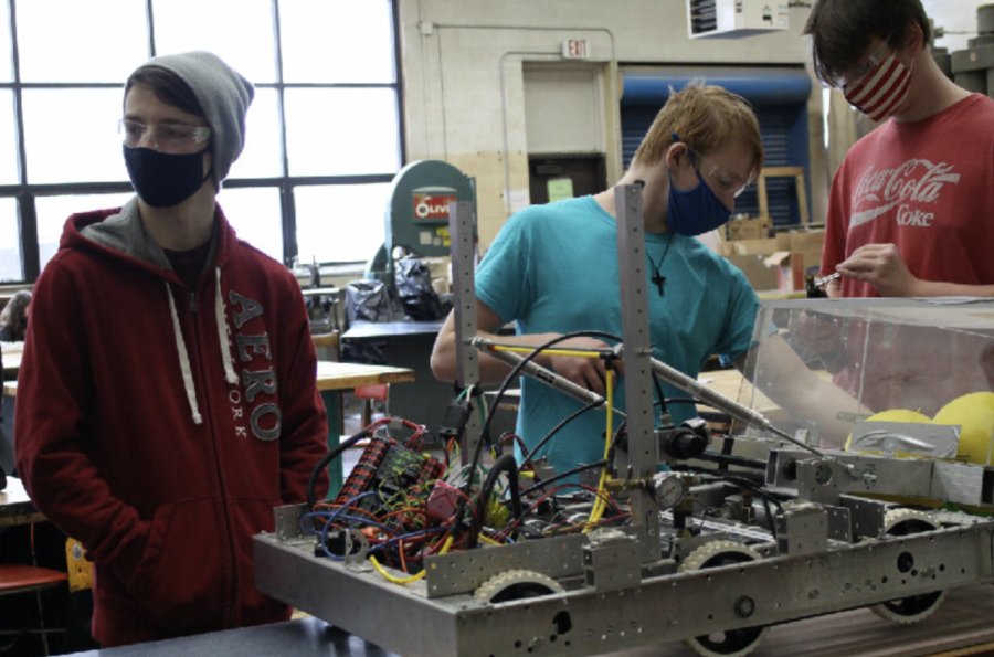 Members of the robotics team practice after school twice a week to build the robot for their competitions.