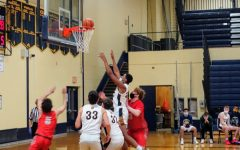 Senior Richard Clark leaps up to grab the ball for a rebound