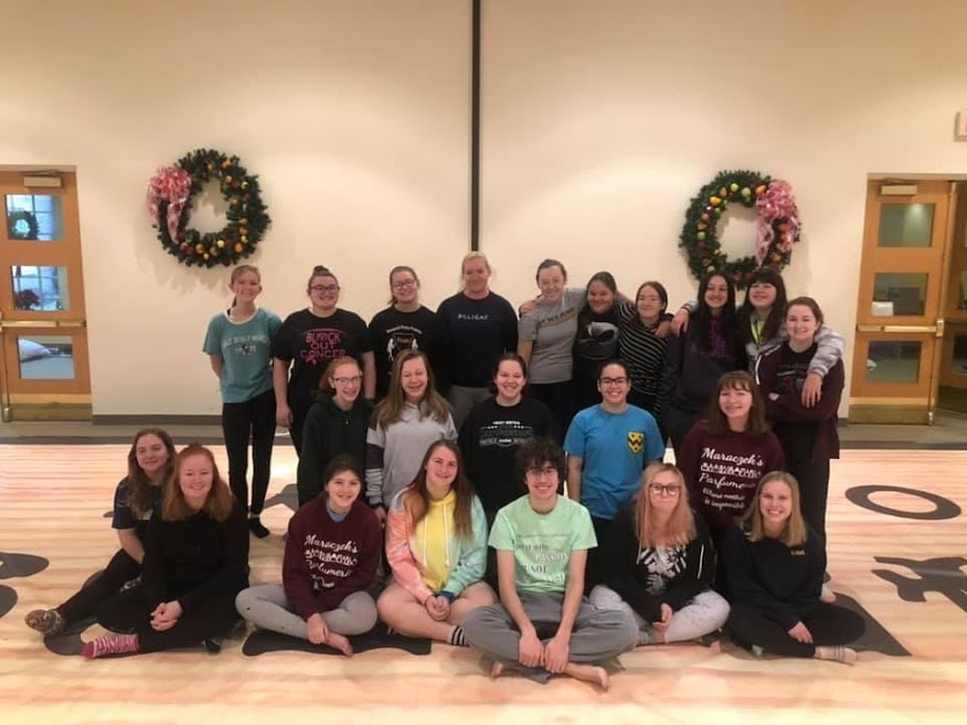 Last year's Winter Guard group pose after finishing their week of 12 hour rehearsals in preparation for their competition season.