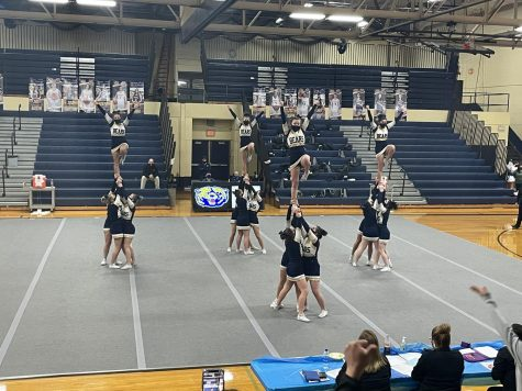The Roosevelt High School Competitive Cheer Team hits their stunt combination in round three with only a few bobbles. The team nailed all three rounds with all tumbling  stuck and no stunts dropped.