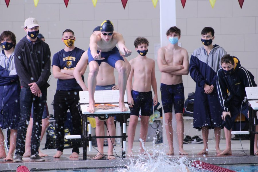 Sophomore Caden Sauve prepares himself to dive into a new team PR in the 200 Free Relay with Jose Hinojosa,  Riley Green, and Jack Vaduva.