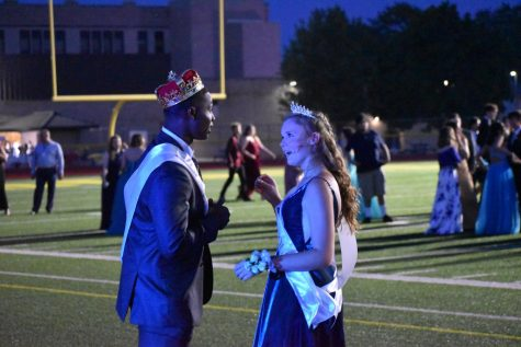 Prom King Jalin Pitchford and Queen Cordelia Krajewski chat after being crowned. Both were also Homecoming King and Queen.