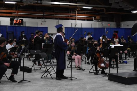 After their performance of West Side Story, a song chosen by the class of 2021 band members, graduates in the band are called to stand up and be recognized for their time dedicated to the program.
