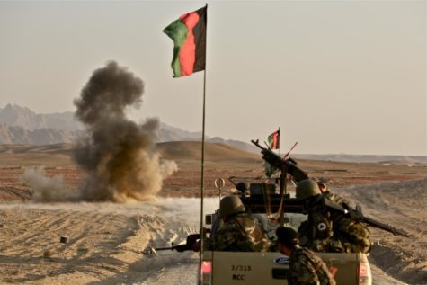 Afghanistan soldiers fire-off their weapons against the Taliban with the help of U.S. troops.